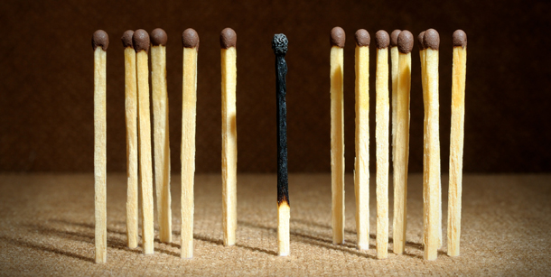 One burnt match among others